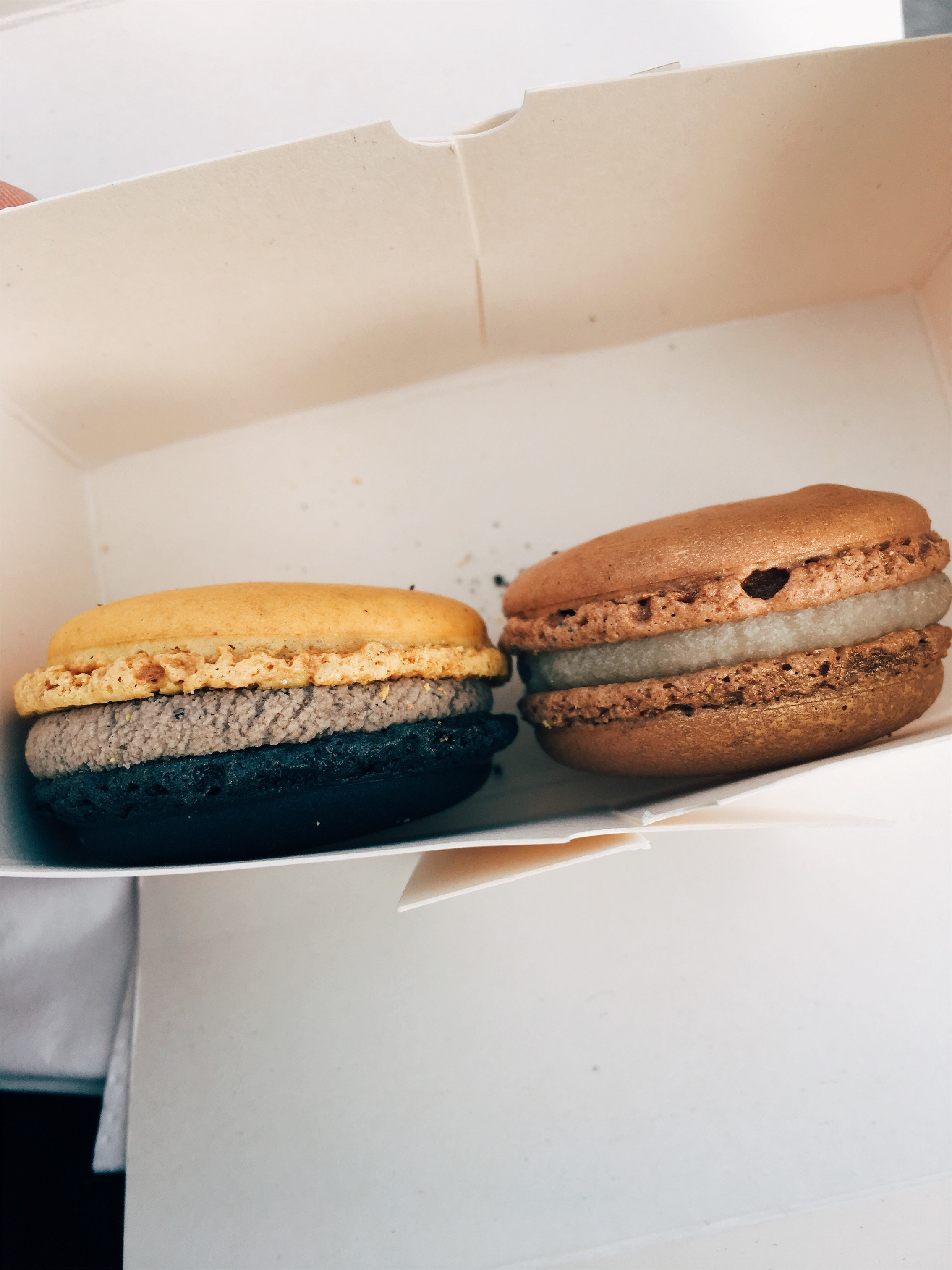 I know what you're thinking, but no that's not sesame. That's actually a black lemon macaron on the left. On the right is date+earl grey